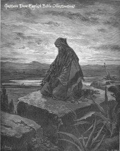 The prophet Isaiah kneels in prayer as depicted by Gustav Dore.