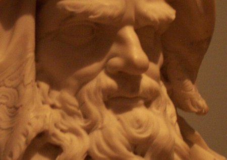 A sculpture of a Greek god.