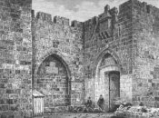 An old black and white photograph of the Jaffa Gate.