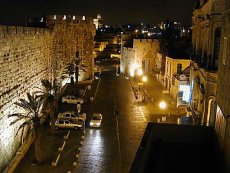 A picture of the Jaffa Gate at night.
