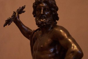 A sculpture of Zeus, king of the Greek gods and evidenced by his lightningbolt.